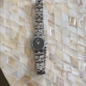Beautiful movado watch with diamonds